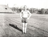 John Bennett stands inside oval at Marquette Stadium, 1951-1952