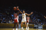 "Glenn ""Doc"" Rivers guards an opponent on the basketball court, 1980? - 1983?"
