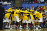 2002-2003 men's basketball team huddle, 2003