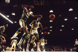 Jim Chones reaches for basketball during a game against Jacksonville, 1972