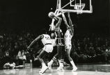Earl Tatum attempts to block a shot, 1974
