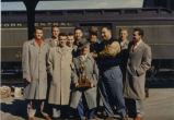 Coach Shimek goofing off with his team, 1953