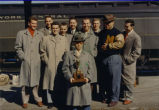 Coach Shimek poses with his team and a trophy, 1953