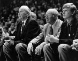 Bob Weingart, Charles Eichenberger, and Pat Foran watch game action, 1981? - 1983?