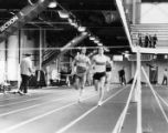 Dave Uhrich and an Ohio State runner near the finish line, 1981? - 1984?
