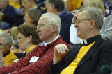 Robert A. Wild, S.J., relaxing at the opening of the Al McGuire Center, 2004