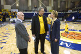 Robert A. Wild, S.J. and basketball coach Terri Mitchell standing on the McGuire Court, 2004