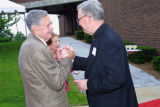 President Robert A. Wild, S.J., and Hank Raymonds greet each other at premiere of the play...