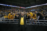 President Robert A. Wild, S.J., cheers with student section at men's basketball game, 1 of 4, 2011