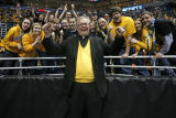 President Robert A. Wild, S.J., cheers with students at men's basketball game, 2 of 4, 2011