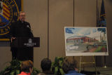 Robert A. Wild, S.J., announces plans for the Al McGuire Center, 2002