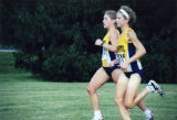Brianna Dahm and Susan Barth run a cross country race, 2000-2002
