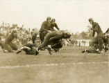 "Ray""Buzz"" Buivid falls after gaining eight yards against Northwestern University, 1934"