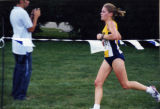 Brianna Dahm finishes a cross-country race, 2000-2003