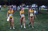 Brianna Dahm walks with teammates after race, 2001-2002