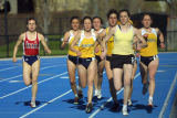 Brianna Dahm runs the inside lane in a track meet, 1 of 2, 2002