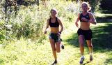 Jessica Swan and Brianna Dahm practice for cross country, 2001