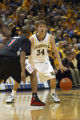 Travis Diener looks for an opening against the opposing team, 2004