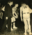 Coach Bill Chandler,  Dave Quabius, and Glenn Adams speak with a referee, 1937-1938
