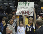 Young basketball fans with a sign for Travis Diener, 2005