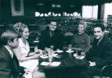 Rob McGuire, Carolyn and Jim Foley, and Pat and Al McGuire at opening game party, 1969