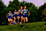 Amy Erickson leads a group of Marquette cross-country runners on a training run, 1997-1998