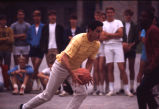 Al McGuire runs with basketball, 1969? - 1970?