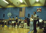 Al McGuire cheers during centennial basketball game, 1980?-1984?