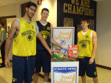 Scott Merritt, Steve Novak, and Travis Diener make a food donation, 2003
