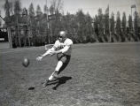 Publicity image of Ward Cuff catching a football, 1936