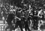 Al McGuire and his team celebrate from the sidelines, 1971