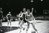 Don Kojis tries to regain possession of the basketball, 1959-1960