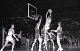 Rear view of Don Kojis making a jump shot, 1959-1960