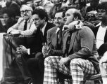 Al McGuire, Hank Raymonds, and Rick Majerus watch game from sidelines, 1977