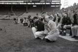 Trainer Bob Weingart watches a Marquette football game, 1957