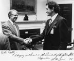 Al McGuire shakes hands with President Carter, 1978