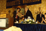 Bob Weingart accepts an award during a testimonial dinner in his honor, 1984
