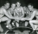 Ken Wiesner and teammates in a huddle, 1944-1946