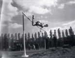 Ken Wiesner clears the bar during a high jump, 1944-1947