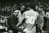 Hank Raymonds, Oliver Lee, and Odell Ball comfort each other during a game, 1977-1978