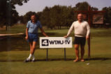 Hank Raymonds and Rick Majerus during golf game, 1978-1983