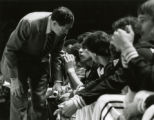 Hank Raymonds coaches a player on the bench, 1982
