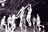 Terry Rand blocks the shot of a University of Notre Dame opponent, 1954
