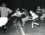Running back Ron Drzewiecki is tackled by an opponent, 1951-1954