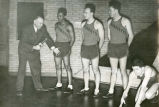 "Conrad ""Con"" Jennings poses with track team, 1942? - 1945?"
