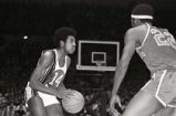 Dean Meminger looks to pass the basketball, 1971