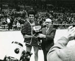 Dean Meminger and Herbert E. Sutter pose with trophy for Most Valuable Player, 1970