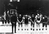 Al McGuire and team members listen to national anthem, 1966-1967