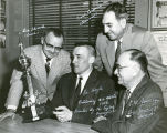 Ed Hoyle receiving trophy from Eagles organization, 1958