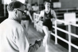 Coach Shimek timing runners, 1975